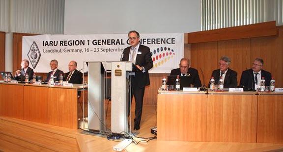 IARU President Tim Ellam, VE6SH, addresses the Convention