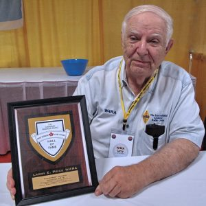 Larry E. Price, W4RA, with Canadian Amateur Radio Hall of Fame plaque.